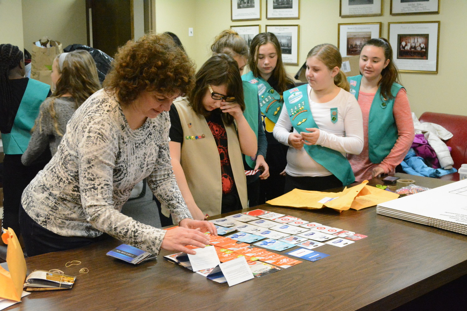 Elaine Notarstefano, leader of Girl Scout Troop #2315, helped sort through thousands of dollars worth of gift cards.