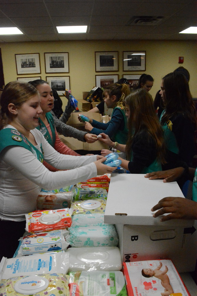 Girl Scouts took the time to organize all of the items people donated.