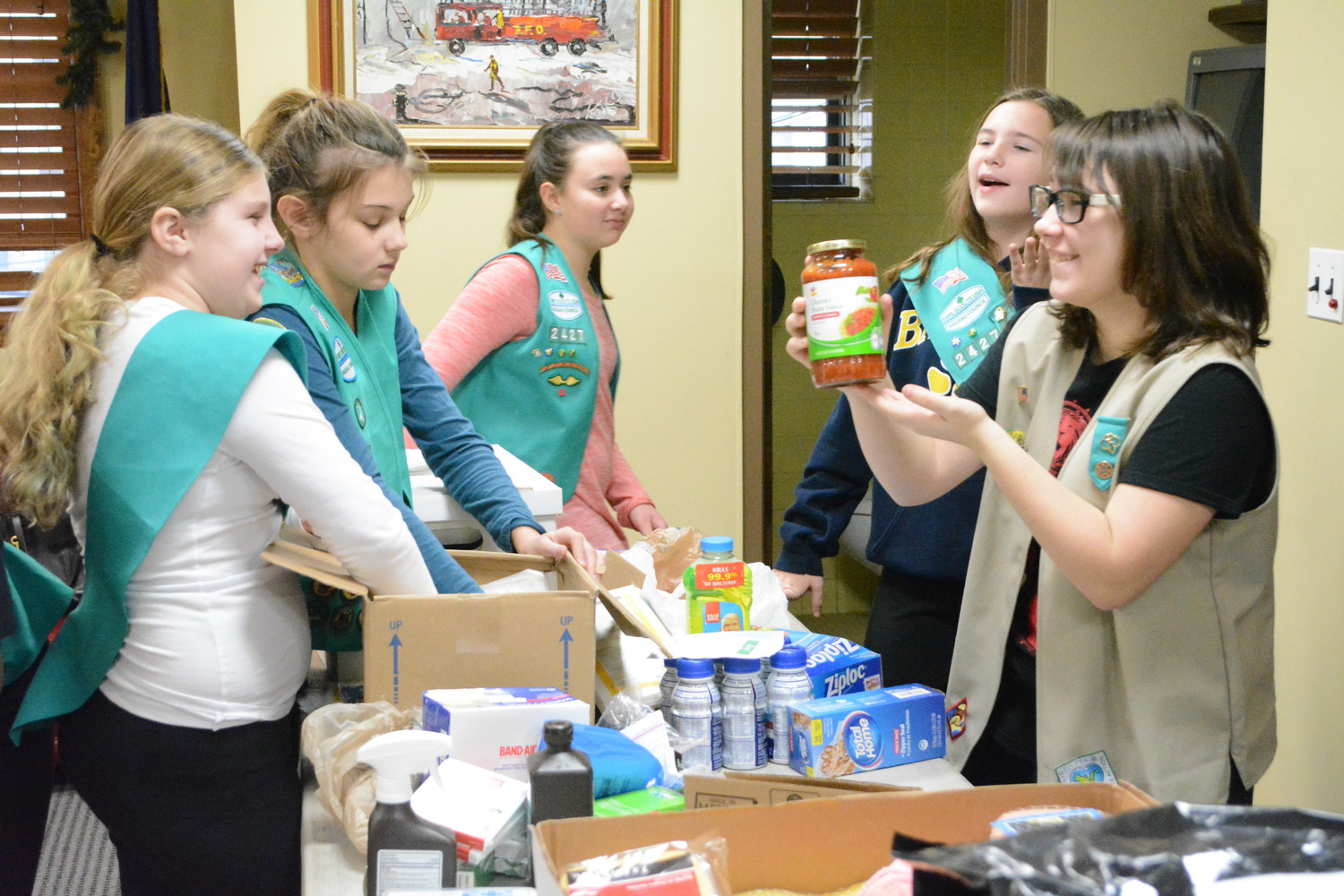 The scouts had fun, laughing and joking around as they sorted through donations from the community.