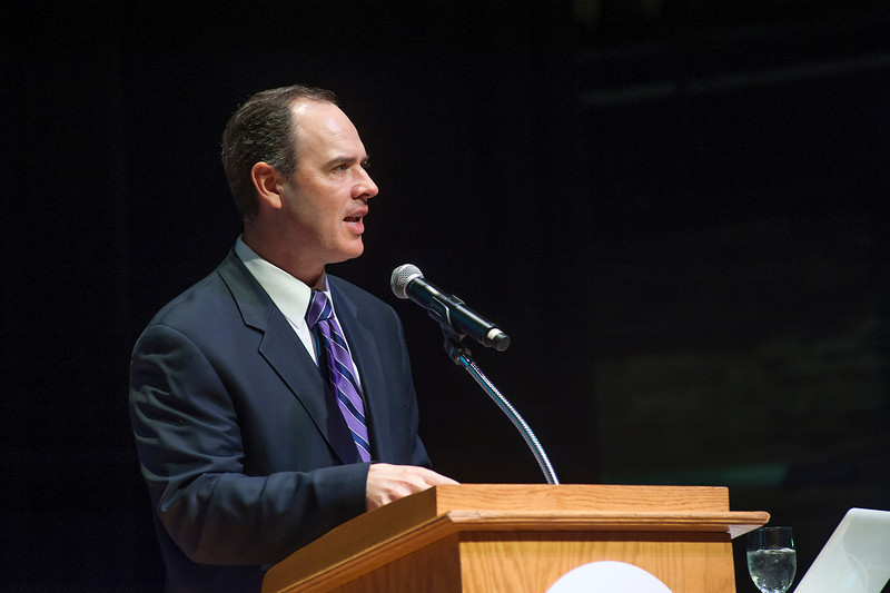 Ed Thompson, Molloy's vice president of Advancement and Mission, pictured speaking at an Energeia event, said that the grant will allow Molloy to better understand how a variety of local issues came about.