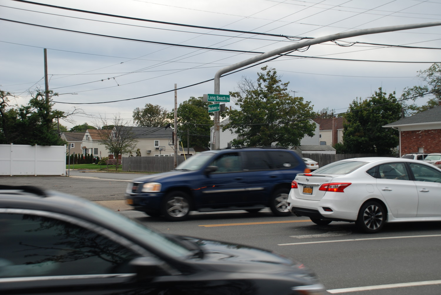 Cars rushed through a busy intersection near Long Beach Road and Henrietta Avenue. The intersection, which was assigned a crossing guard earlier this month, has been the subject of recent discussions about pedestrian safety.