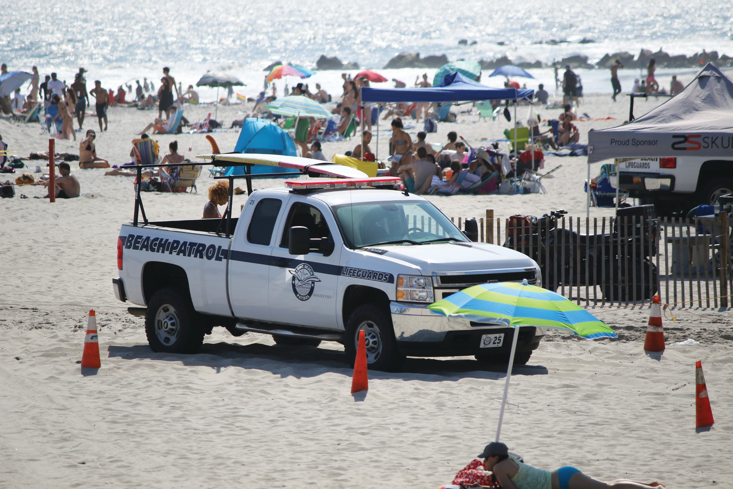The city said that police SUVs, similar to this lifeguard truck, are no longer used to patrol the beach, and will only respond to 911 calls there.