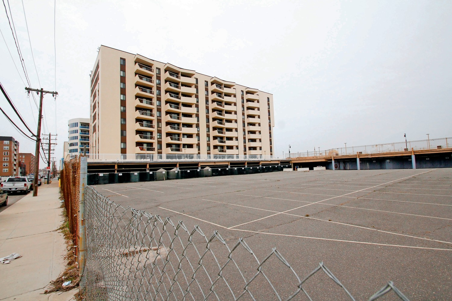 A developer alleges that the city's zoning board bowed to pressure from residents of Sea Pointe Towers, above, when it revoked permits to build adjacent condos.
