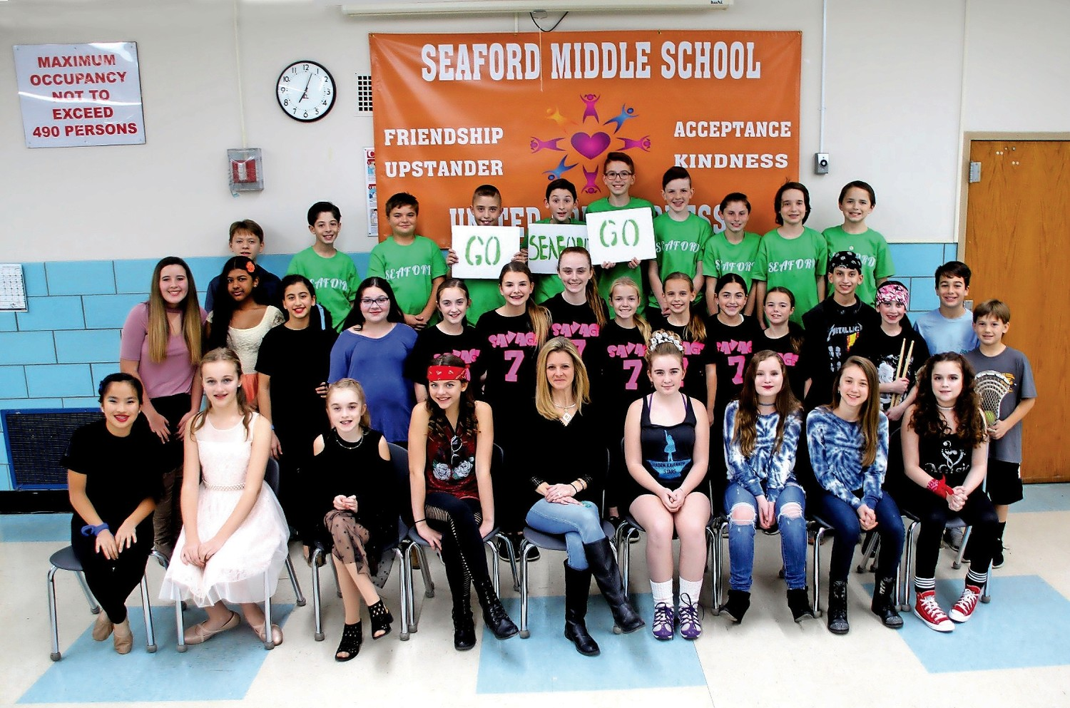 "Students from Seaford Middle School performed in ""Seaford's Got Talent"" on Dec. 7. Coordinator Christina Urso, center, organized the event."