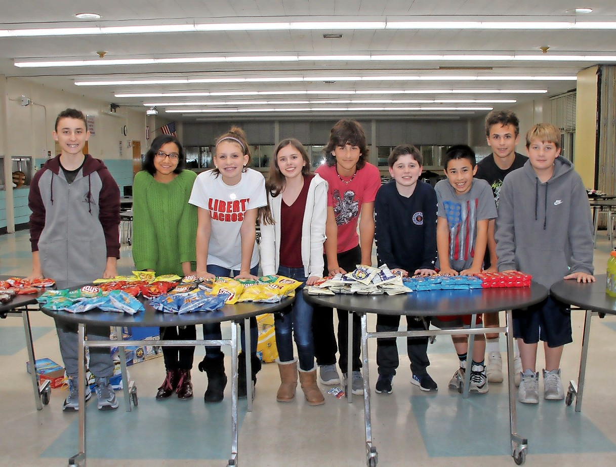 Seaford Middle School students sold treats at the event. From left, Peter Tobacano, Rabeya Shahid, Emily Montagano, Angela Dean, Anthony Munro, Jack Zuckerman, Dylan Vassilio, Nicholas Bartololomeo and Owen Wendt.