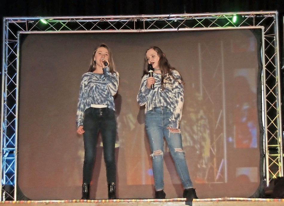 Emily Smith, left, and Erin Augusiewicz performed at the talent show last week.