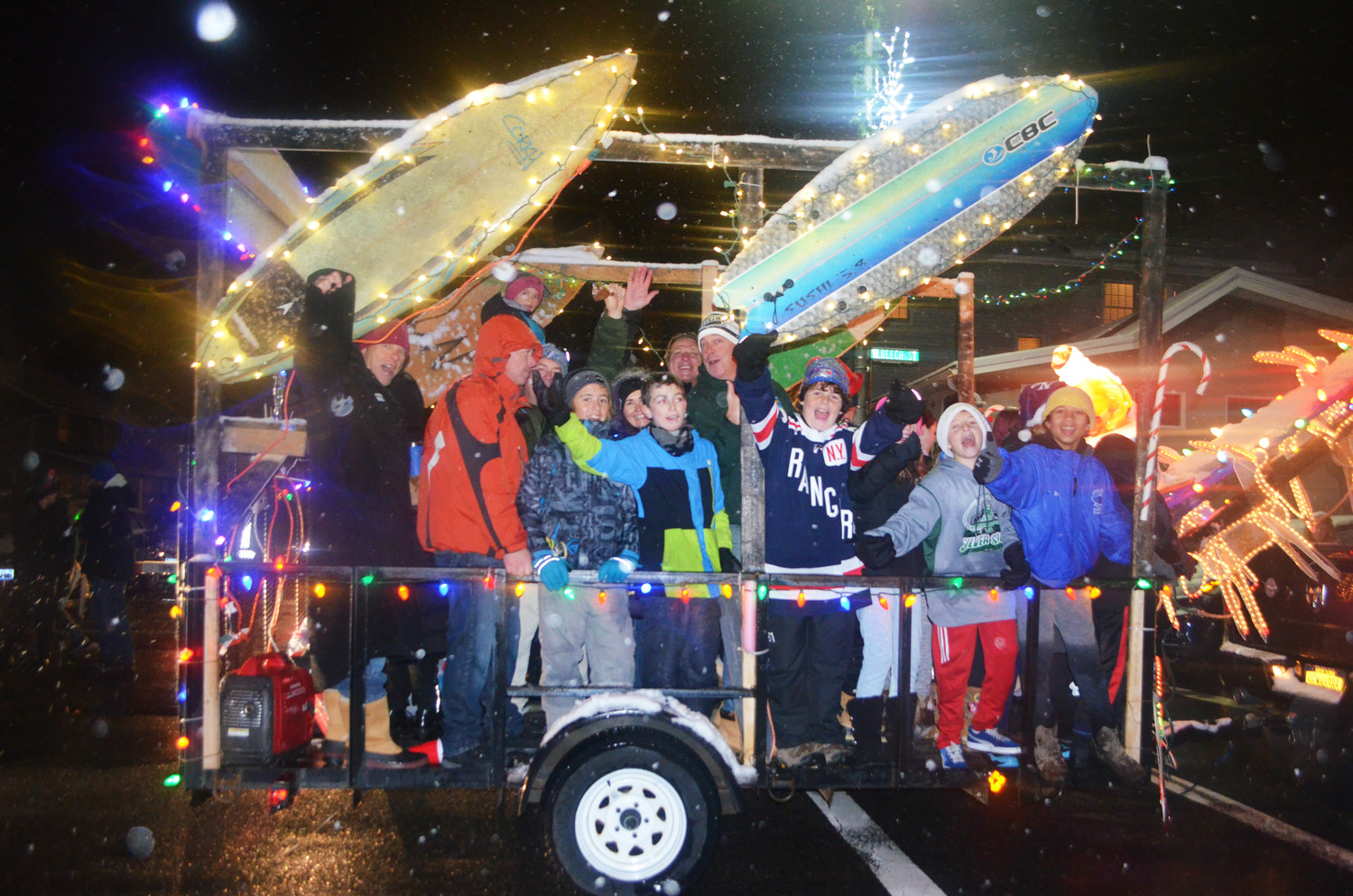 More than 1,000 people gathered in the West End last Saturday for the fifth annual Long Beach Electric Light Parade, featuring antique cars, fire trucks and floats decorated in festive lights.