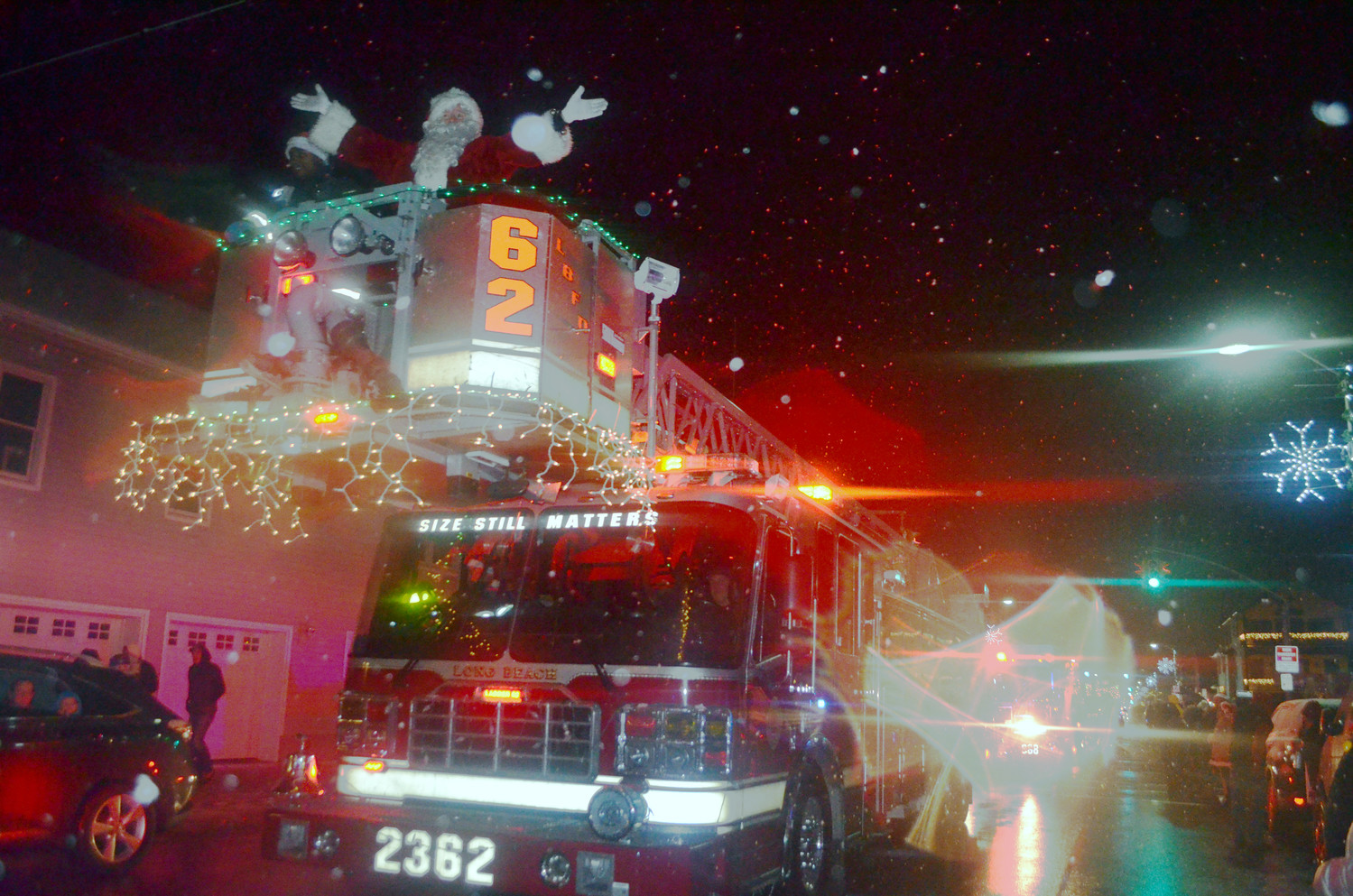 The Long Beach Fire Department was joined by Santa Claus as he waved to onlookers at the fifth annual Long Beach Electric Light Parade on Saturday.