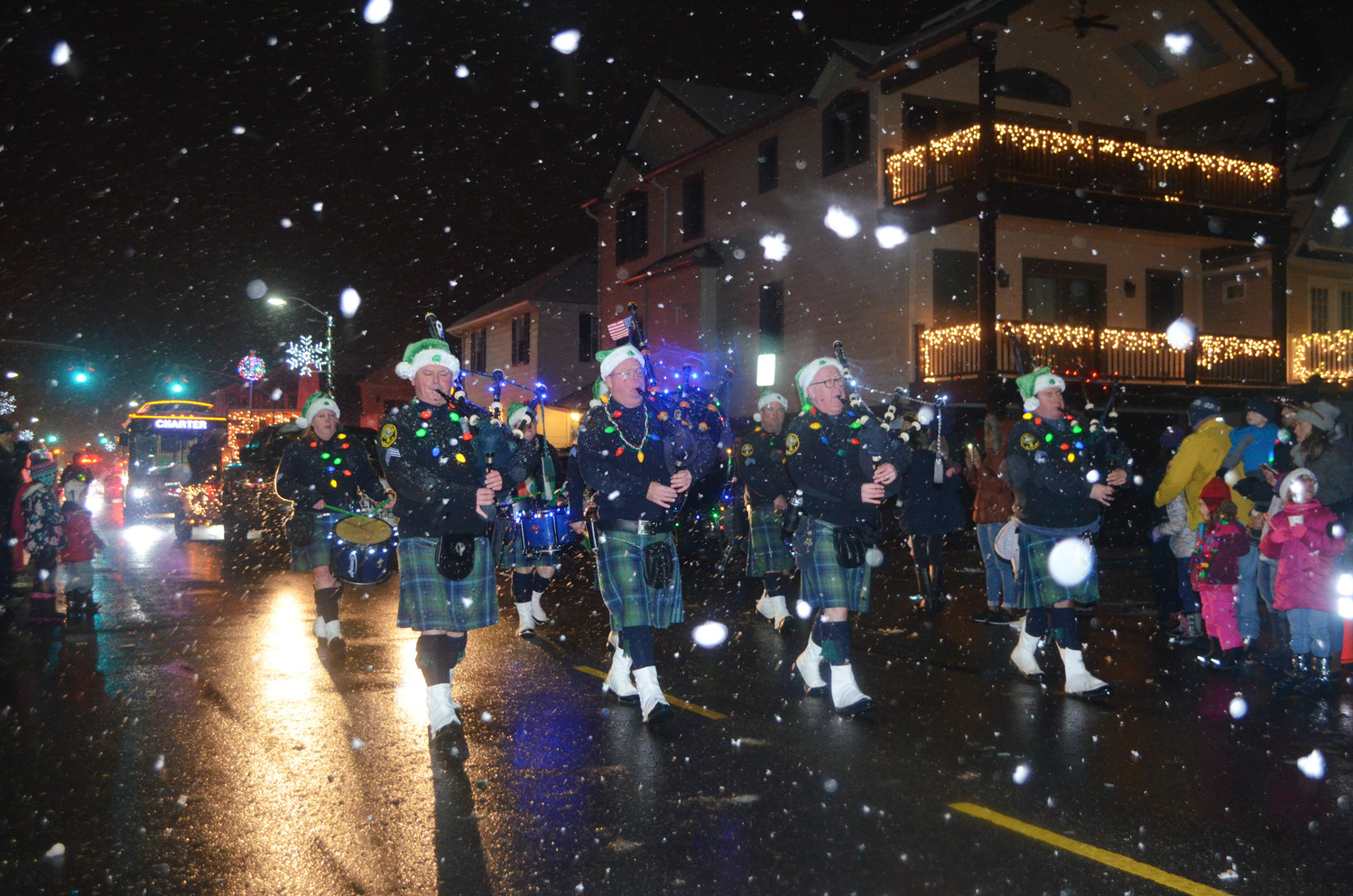 Members of the Breezy Point Catholic Club Pipes and Drums marched down Beech Street and entertained parade goers.