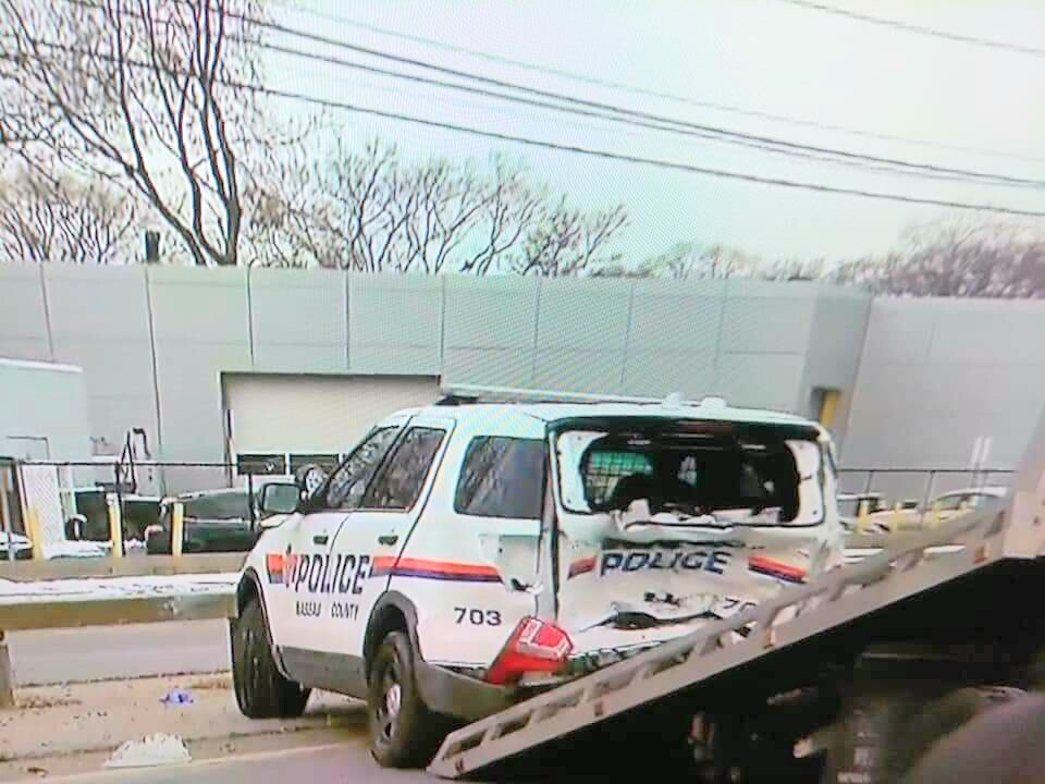 A Nassau County police officer was hospitalized after a car crash in Seaford Friday morning.