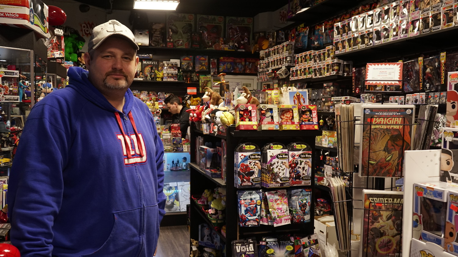 "Island Collectibles owner Jason Sidelman in his shop. ""We're always evolving,"" he said of the philosophy behind his business."