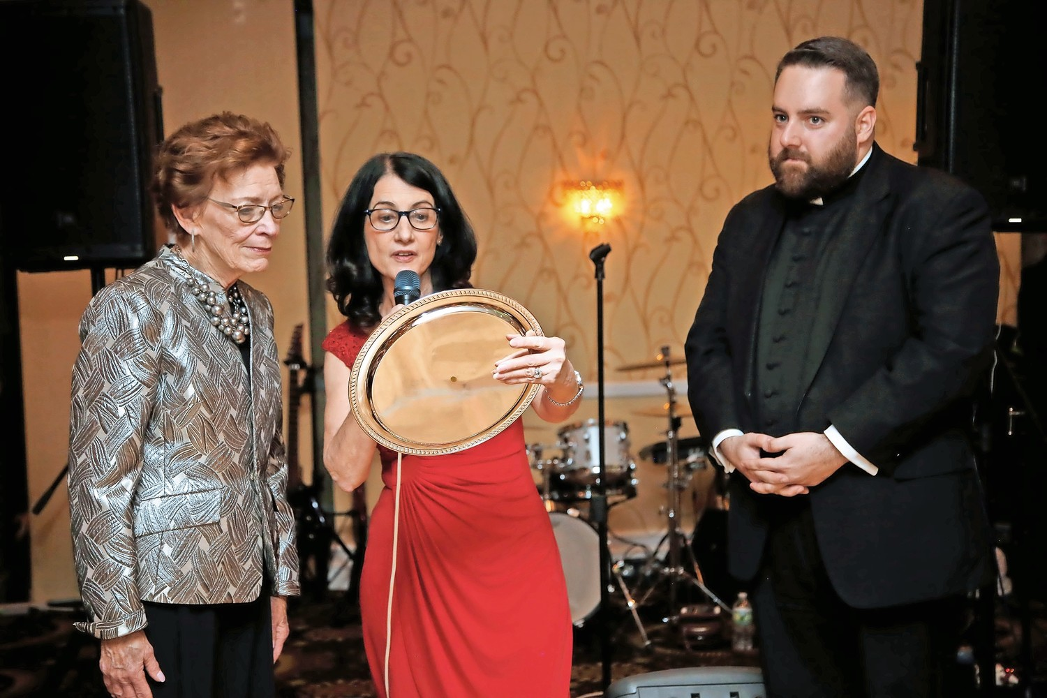 O.L.L. Principal Mary C. Murphy, middle, with the Rev. Michael Duffy, presented Maier with a platter.