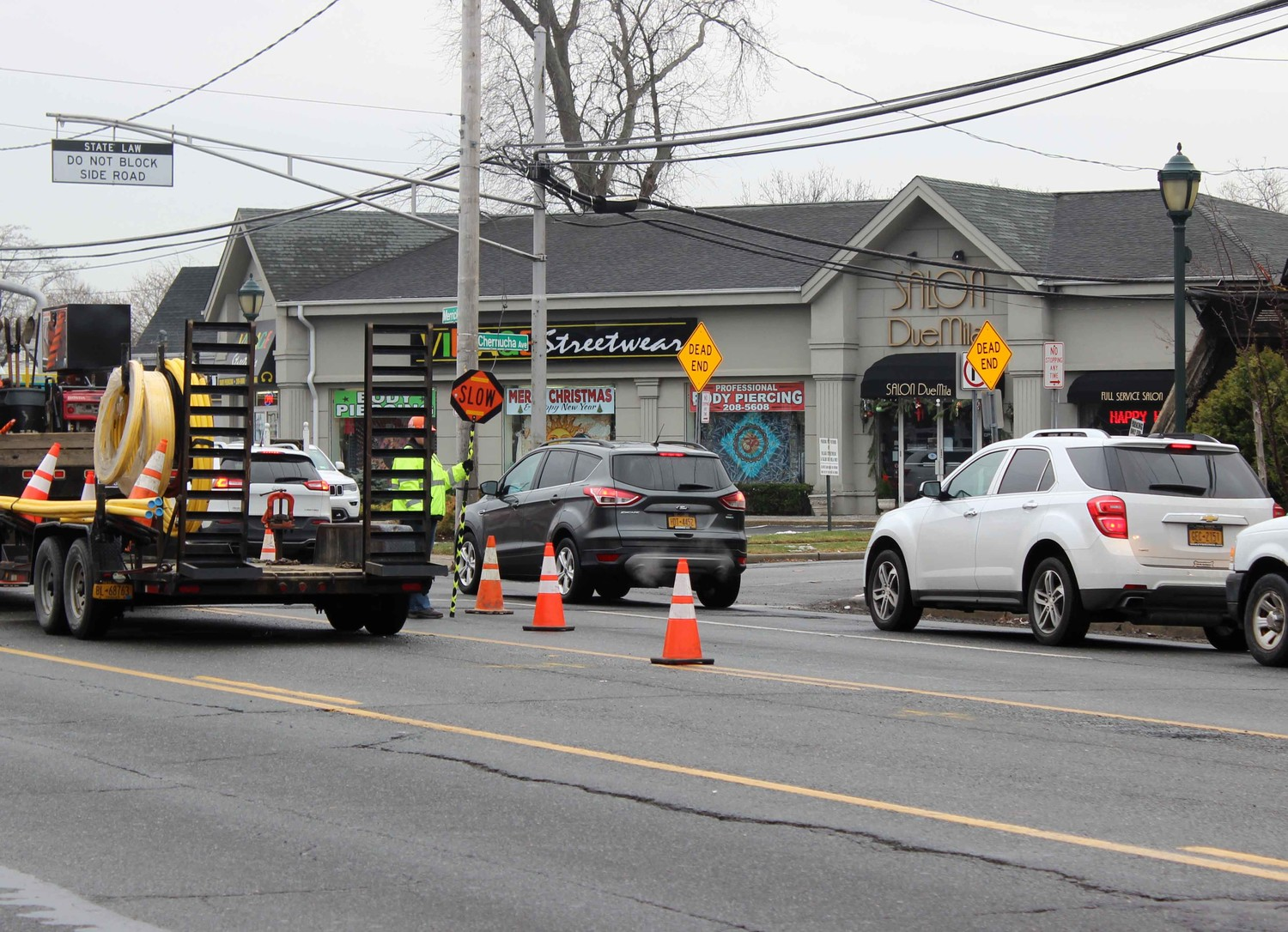 Local business owners said that a National Grid construction project on Merrick Road has hindered their holiday rush.