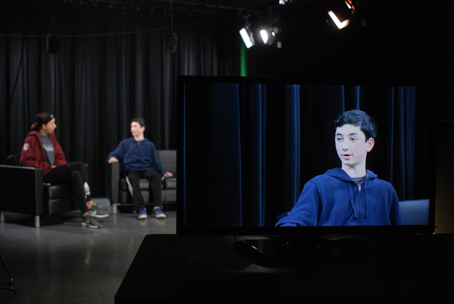 Tenth-grader Spencer Mattes played the role of Gomez during a run-through in preparation for the interview.