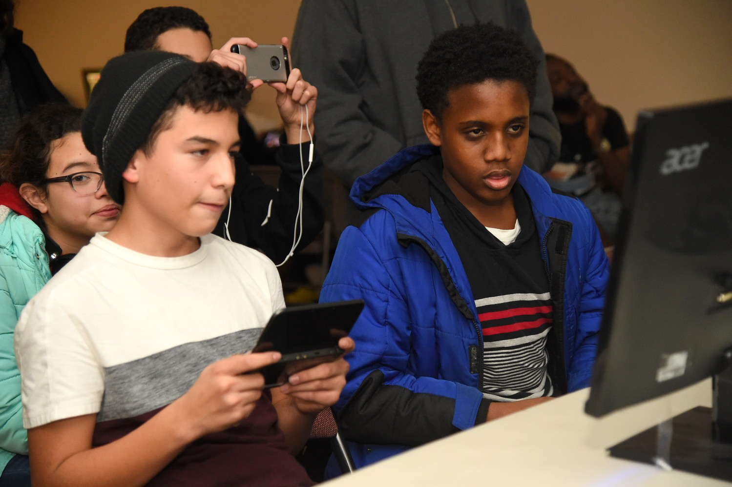 Making their way to the final round, Kenny Hernandez, 14, left and Daven Lewis, 13, right, went head to head during the Smash Freeport video game tournament held at the Freeport Memorial Library on Dec. 15.