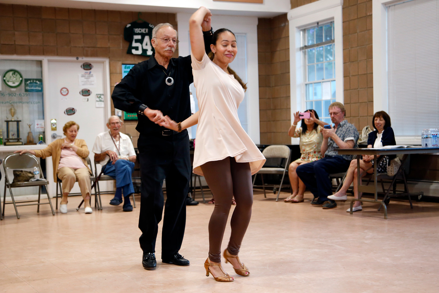 Guy Ferrara, above with dancing partner Karina Hernandez, led several free salsa dancing lessons for senior citizens in Valley Stream this year. His entertaining persona has earned him something of a cult following.