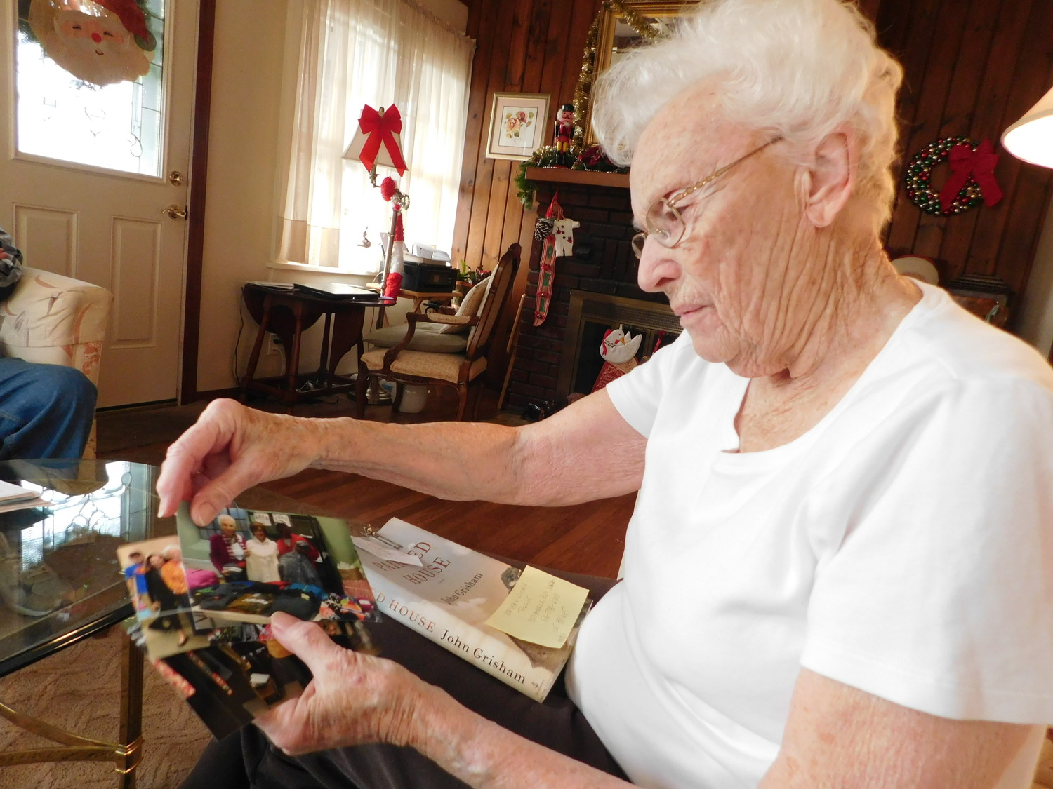 Gloria Chapman thumbed through her photo collection, which details more than two decades of volunteering to help Nassau County's needy.