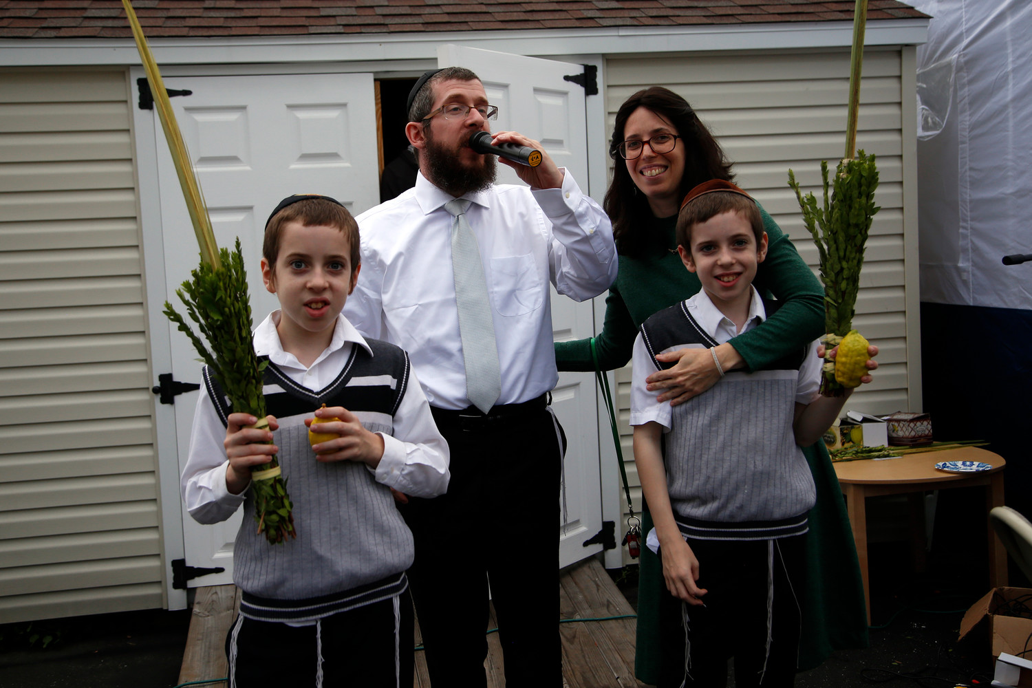 The Kramers and their sons led Simchat Torah festivities this year at the Chabad Center.