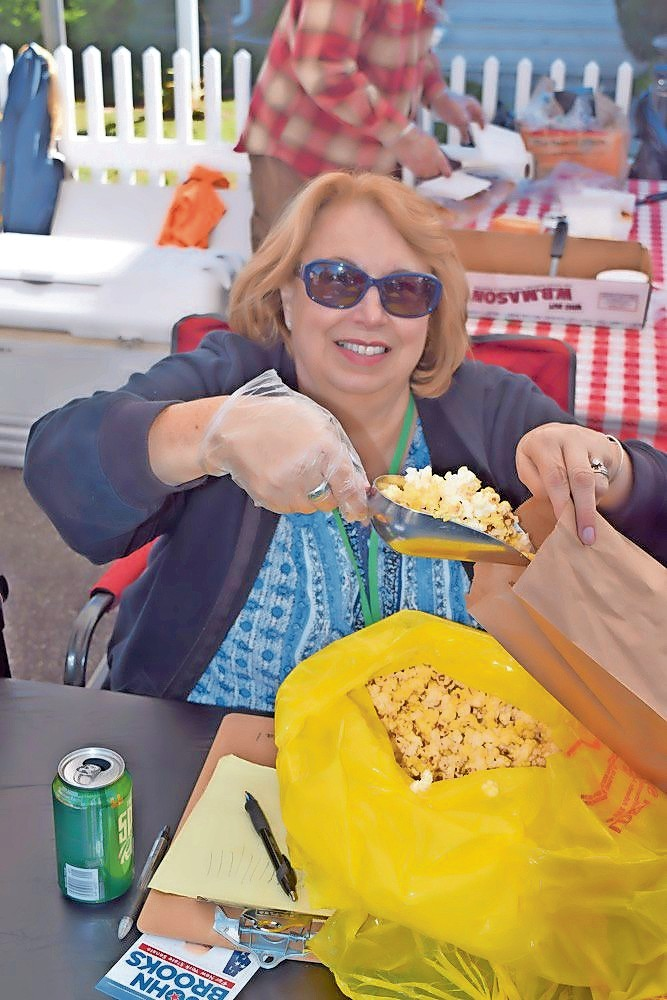 Judy Bongiovi, president of the Seaford Historical Society, is involved with all things Seaford. Last year she handed out popcorn at the organization's annual Fall Harvest Fair.