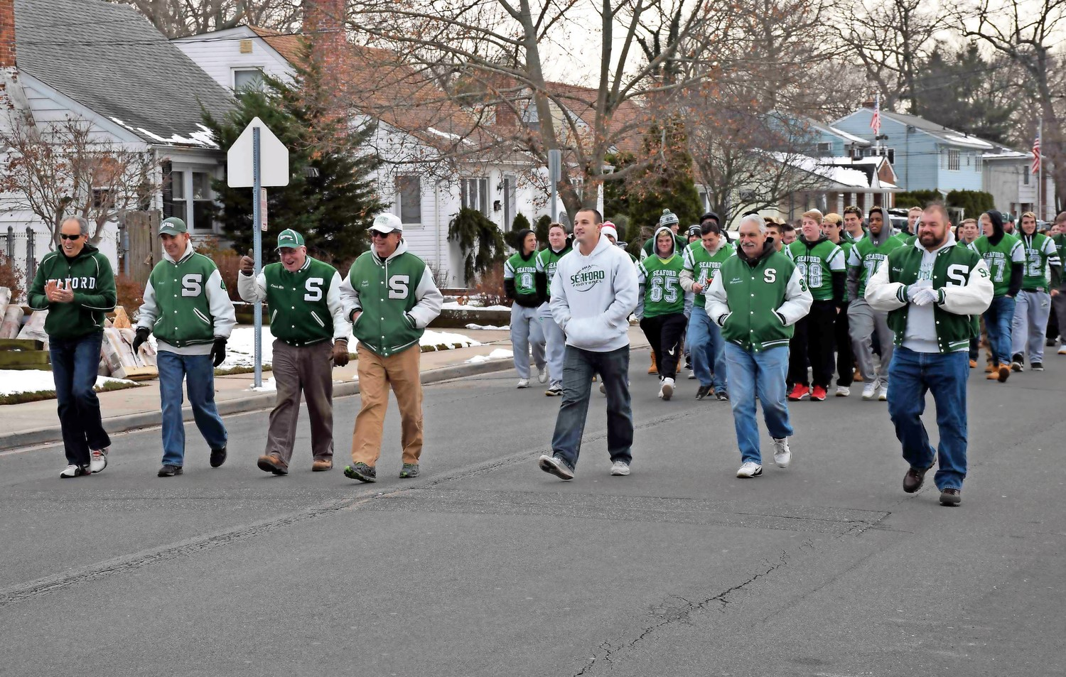 Seaford High School's football coaches and players marched on Washington Avenue during a Dec. 17 victory parade celebrating their Long Island title.