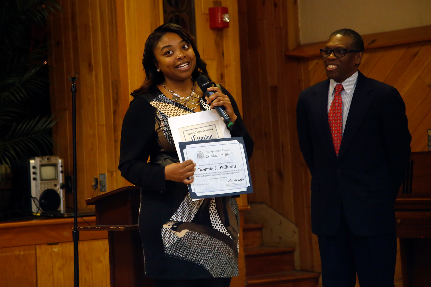 Tammie Williams, above with Aubrey Phillips, was honored for her work as a community activist in February, during Black History Month, at St. John's United Methodist Church of Elmont.