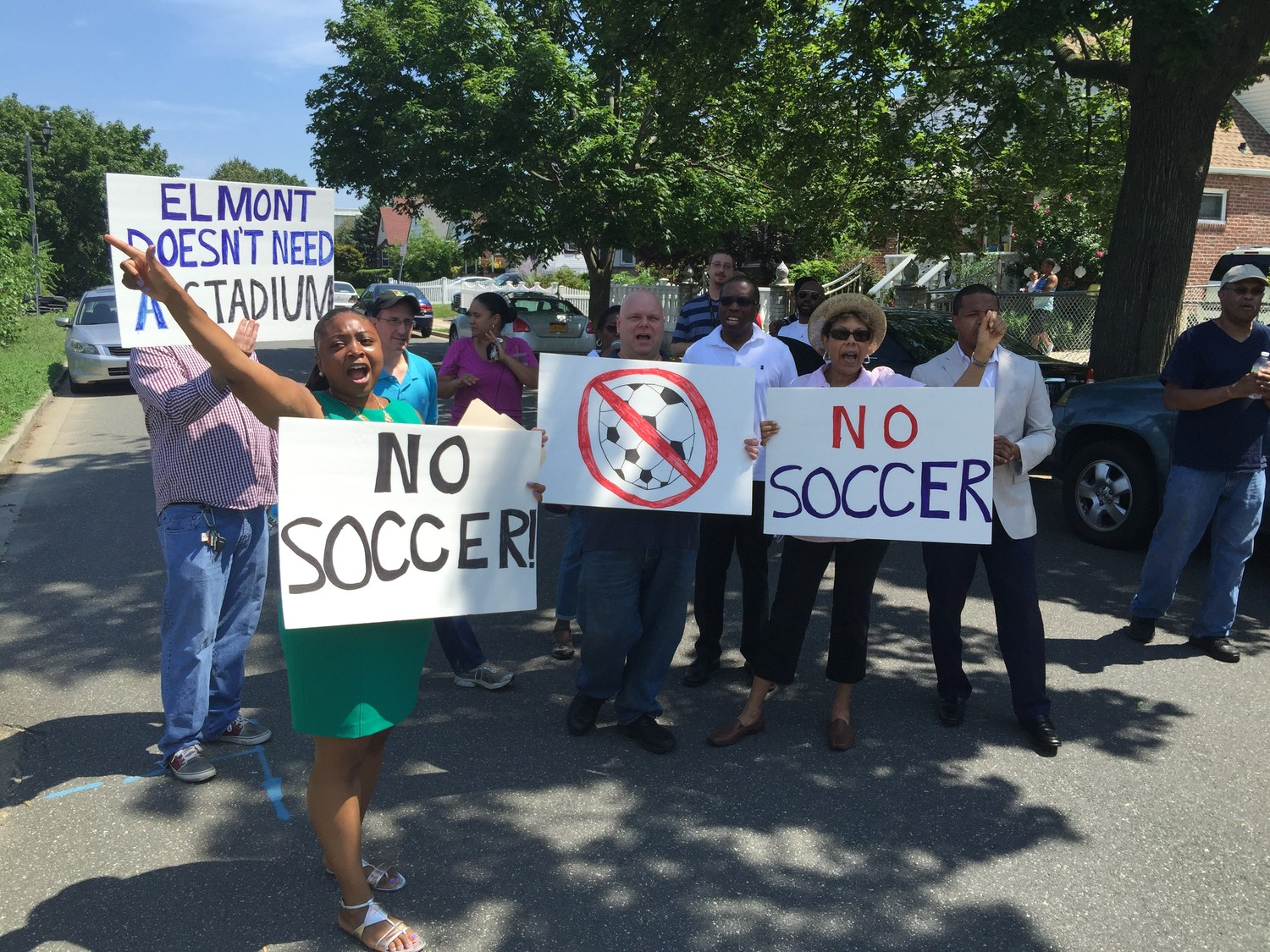 At left, Williams led a rally in opposition to the proposed soccer stadium near Belmont Park in July 2016.