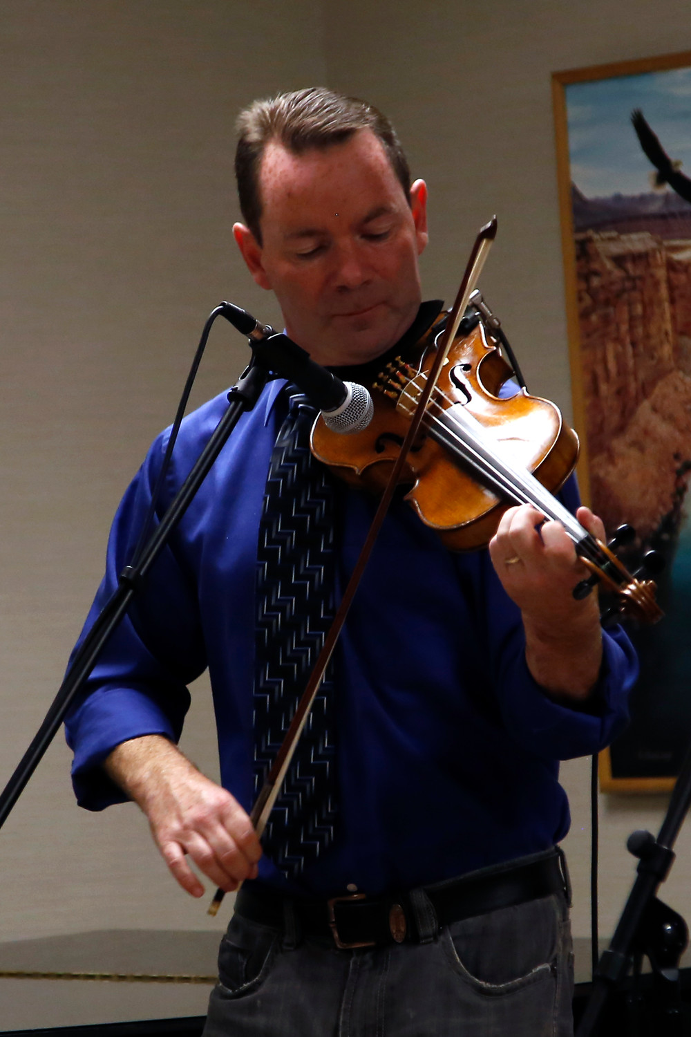 Eamon O'Roake, born in Ireland, joined the band in its 37th season and became the band's fiddle player.