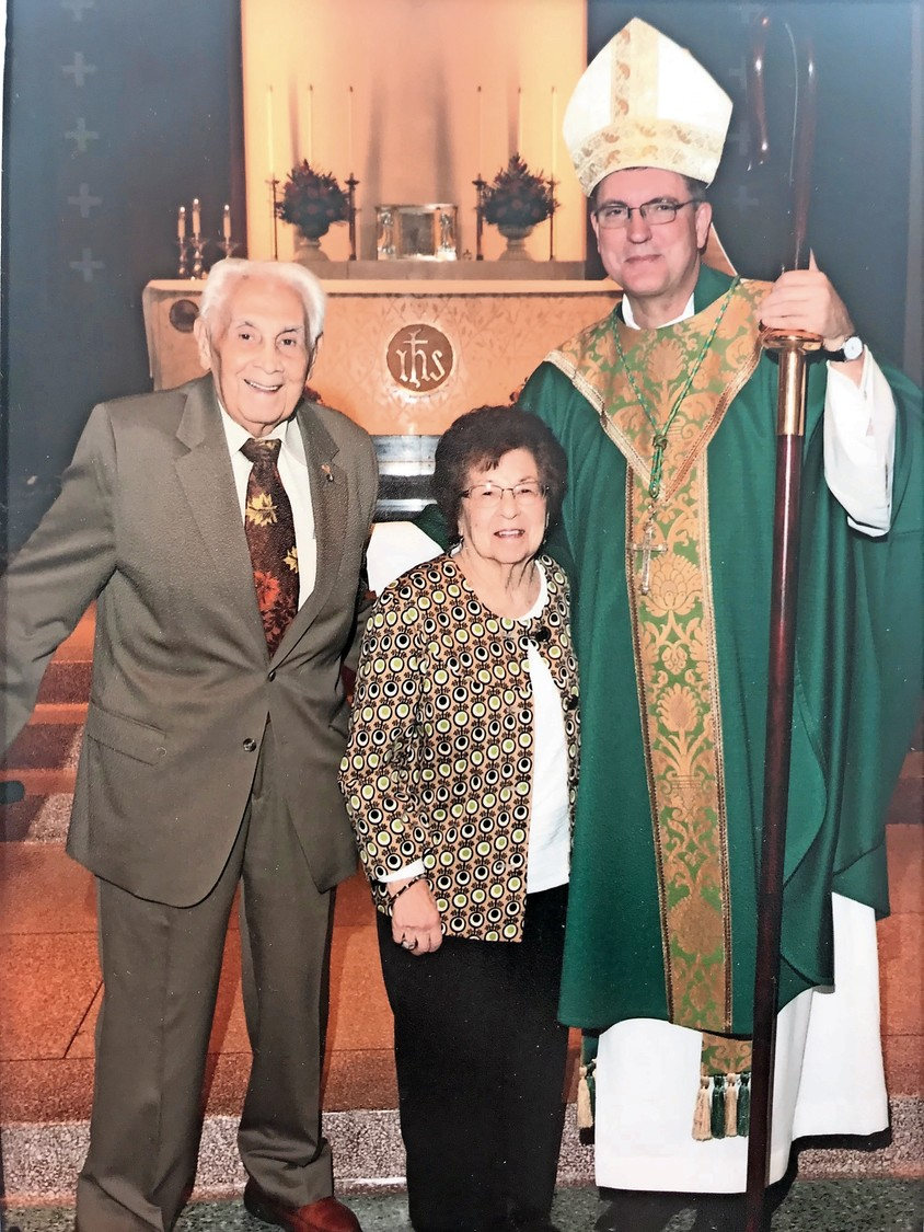 A bishop at St. Rose of Lima Catholic Church in Massapequa blessed couples married for more than 50 years, including the Luccas.
