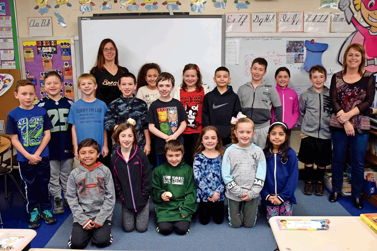 Students in the Mindfulness Club at Lee Road Elementary School in North Wantagh discussed the importance of a healthy lifestyle with advisor Melanie Anderson, back left, and assistant teacher Arlene Zabatta, back right, at a meeting on Dec. 8.