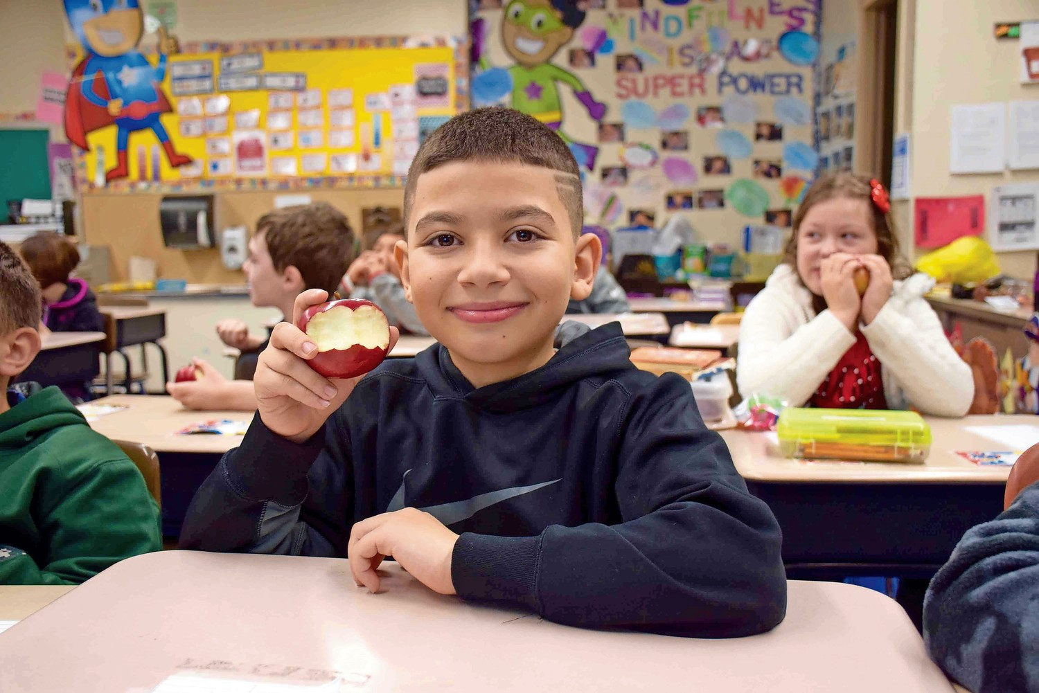 Fourth-grader Steve Mavrommatis learned how to mindfully eat an apple.
