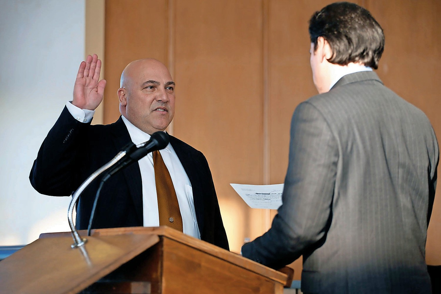 Councilman John Bendo was sworn in by State Sen. Todd Kaminsky. He called for bridging political divides on the council.
