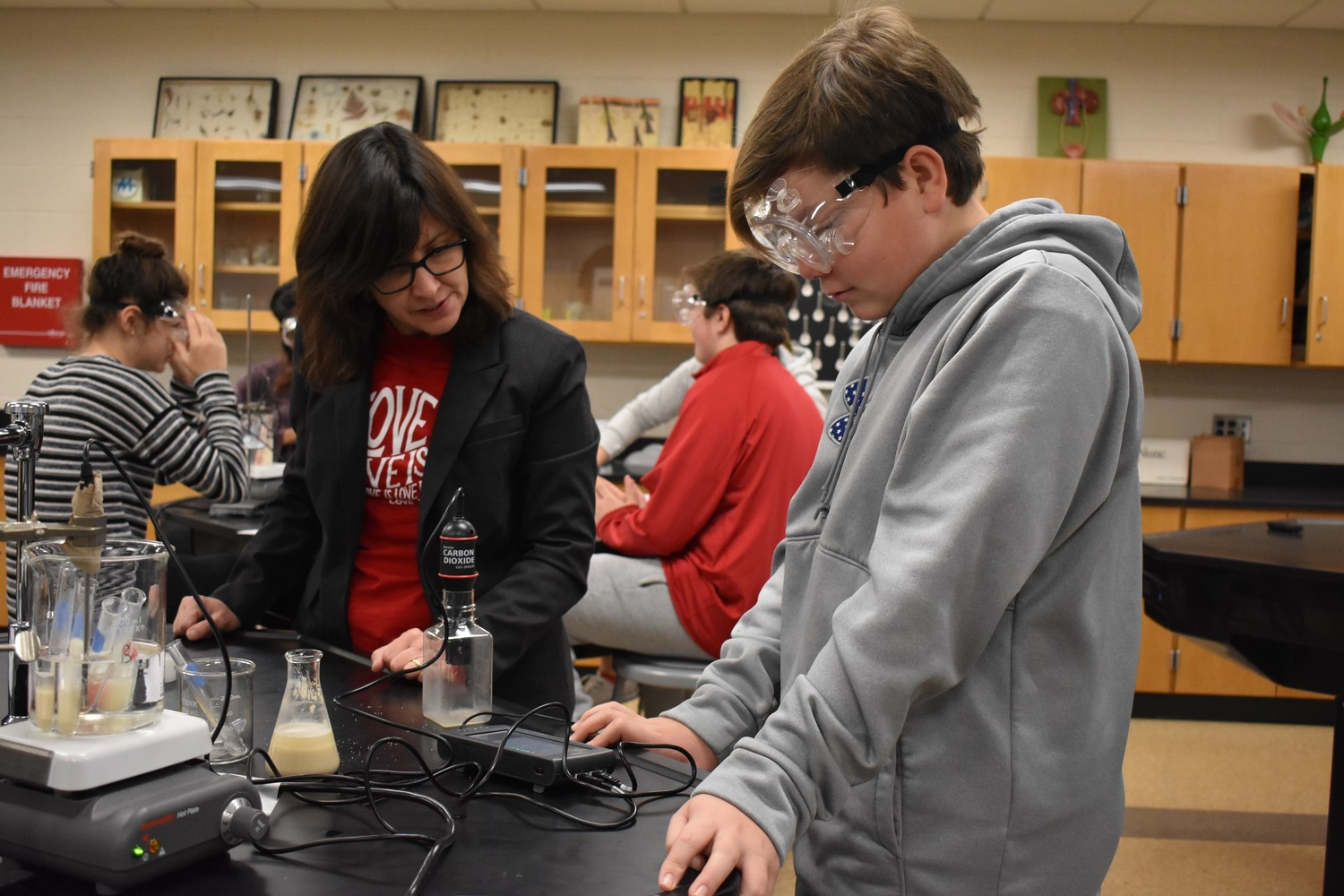Cameron Formes, right, with teaching assistant Michelle Gamache, analyzed the amount of carbon dioxide released during anaerobic respiration of yeast.