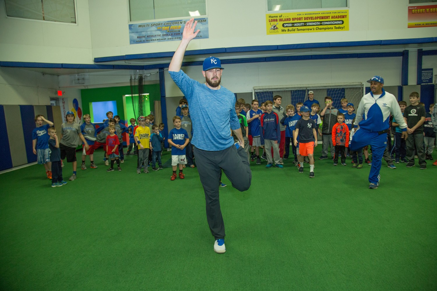 Royals relief pitcher Kevin McCarthy led some of his young fans in stretching on Dec. 19, when he returned to Rockville Centre's Sportset Health and Fitness Club, where he used to train.