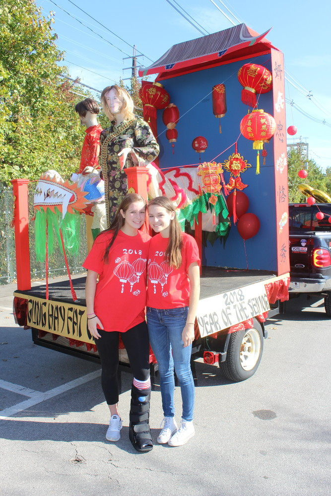 South Side High School senior Caroline Lanzillotta, left, and her twin sister, Julia, help lead Homecoming each fall as vice president and president, respectively, of the class of 2018. They helped design this year's Chinese New Year-themed float.