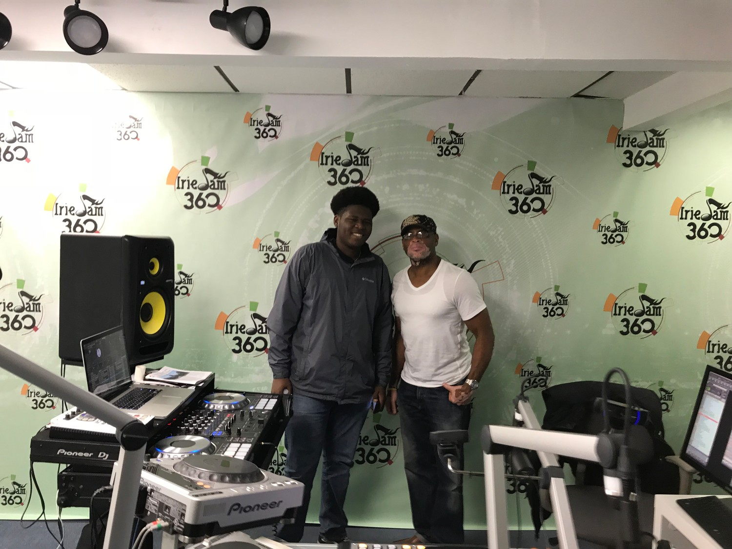 "Daniel Foster, left, with DJ Wayne ""Oxtail"" Jackson, who's show on Irie Jam 93.5 FM he appears on once a month."