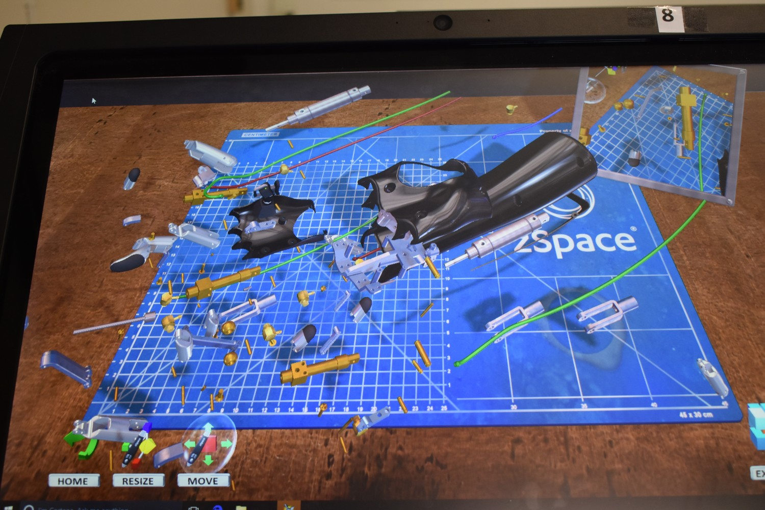 A robotic arm, which can be taken apart and assembled, is just one of the many programs on the zSpace computers.