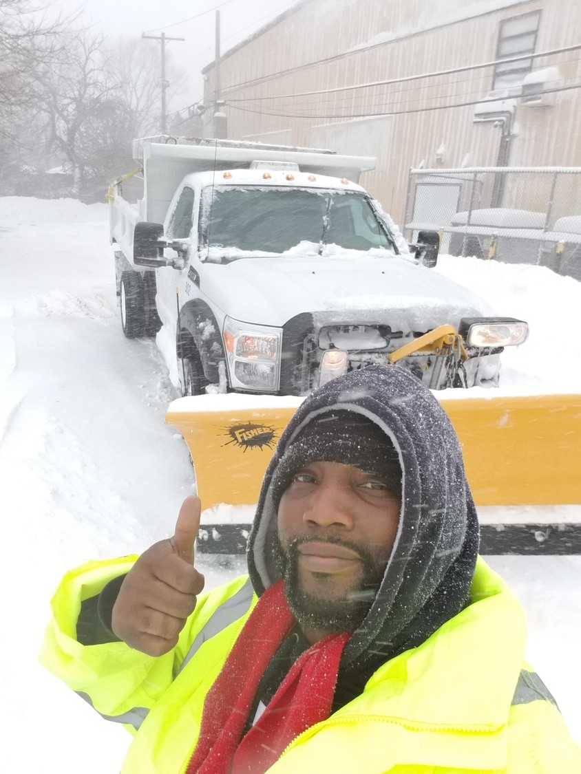 Martin Luther King Center Board Chairman James Hodge took a selfie on Thursday with a snow plow. City crews were out in force clearing streets to make conditions safer for residents.