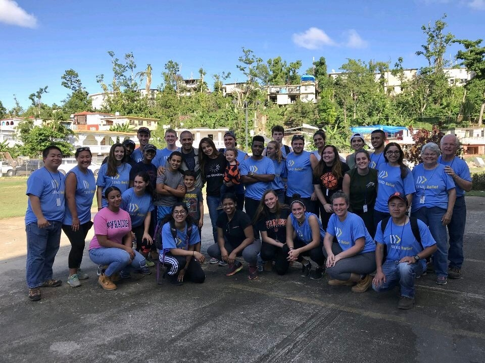 Syracuse University students spent a week of their break helping victims of Hurricane Maria in Puerto Rico. Elissa Candiotti is second from right in the front.