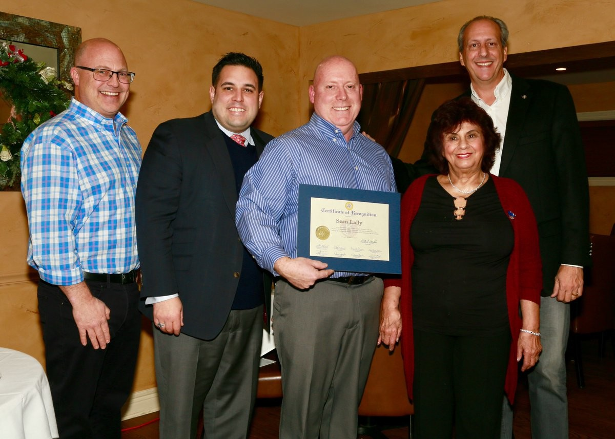 Five Towns Kiwanis member Sean Lally is the group's Kiwanian of the Year. From left were past Kiwanis President David Vines, Councilman Anthony D'Esposito, Lally, Ann DeMichael and club President Tom Cohen.