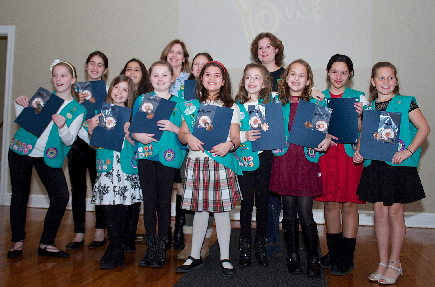 Leaders Dianne Russo (sixth from left) and Kristin Herron were proud of the girls from Troop 211 who earned Bronze Awards.