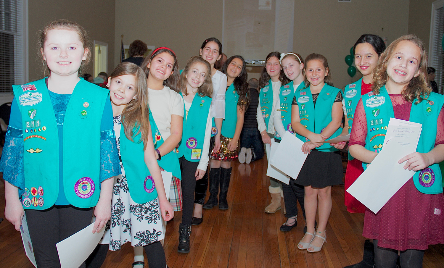 Troop 211 waited for guests to arrive at the entrance of the Oyster Bay Community Center, where their Bronze Award ceremony was held on Dec. 22.