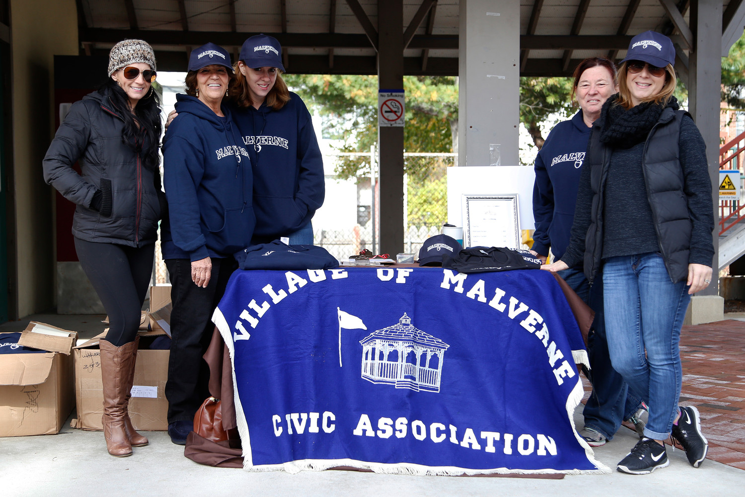 Malverne Civic Association members, from left, Suzanne Parra, Toni Sussman, Kristen Smith, Kathi Monroe and Jennifer Prizzi hosted the group's annual E-Cycle event at the Malverne train station in November.