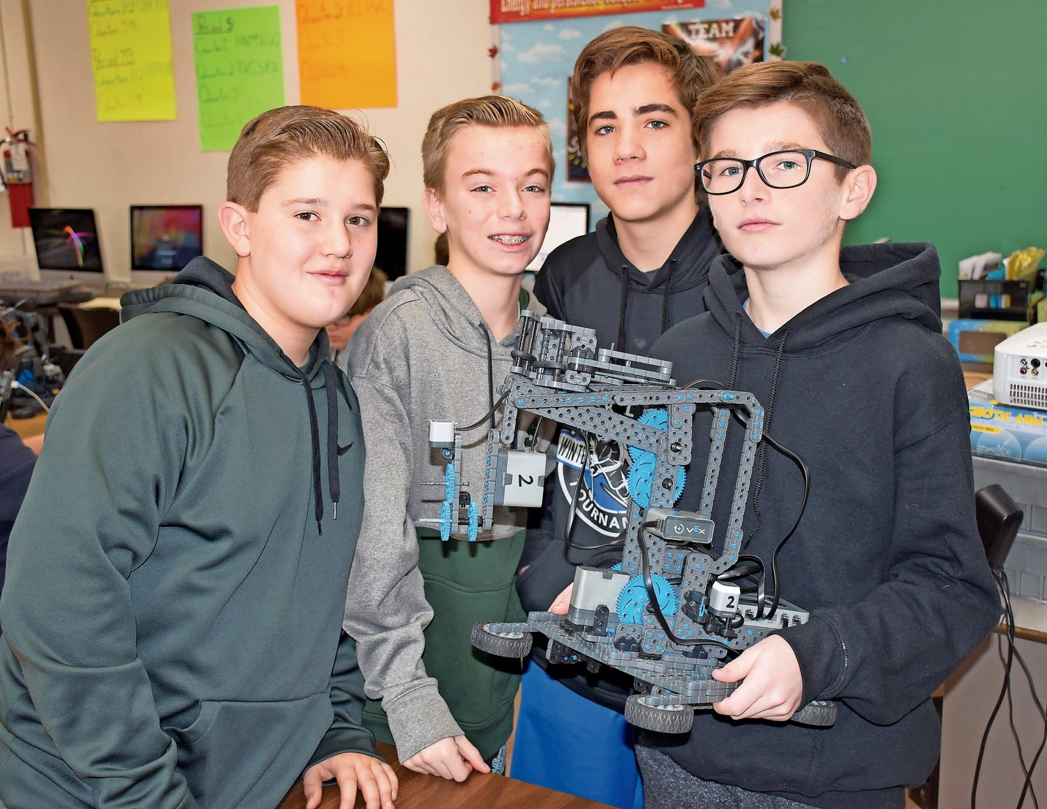 Seaford Middle School eighth-graders, from left, Jimmy Manzick, Paul Anzelone, Evan Paccione and Brandon Owens learned about robotics in a new half-year technology course.