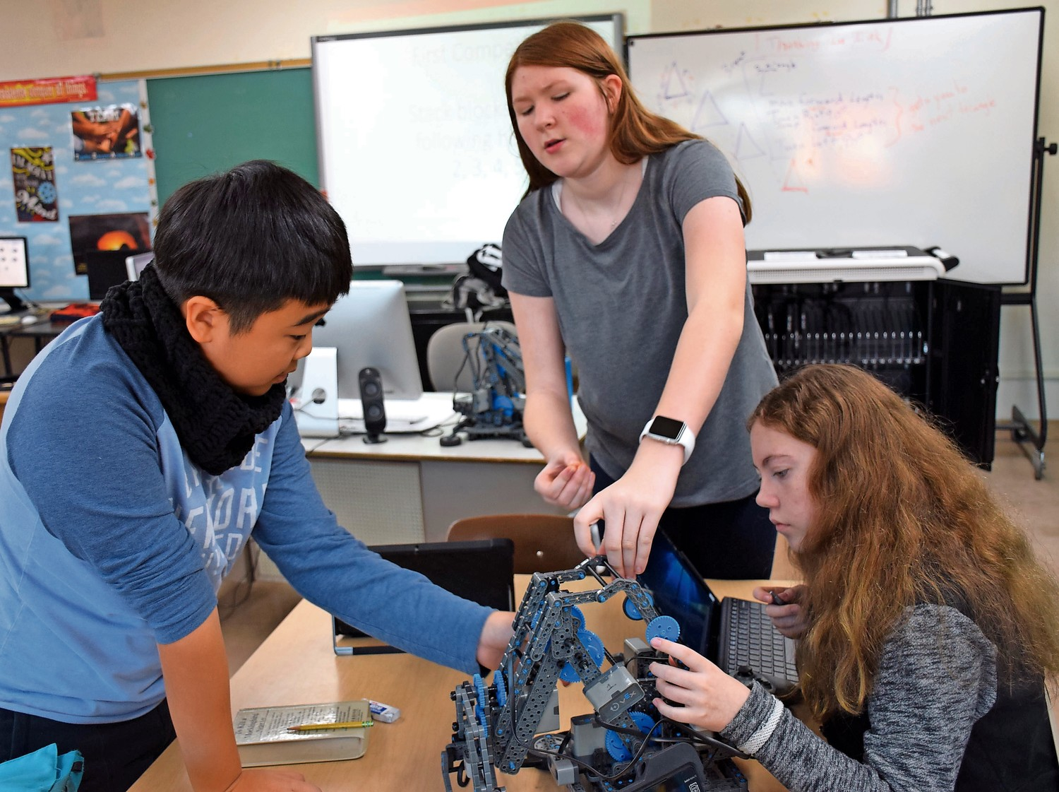 Hyosung Yang, Sabrina Joerg and Jessica Augustin, right, went to work building their latest robot.