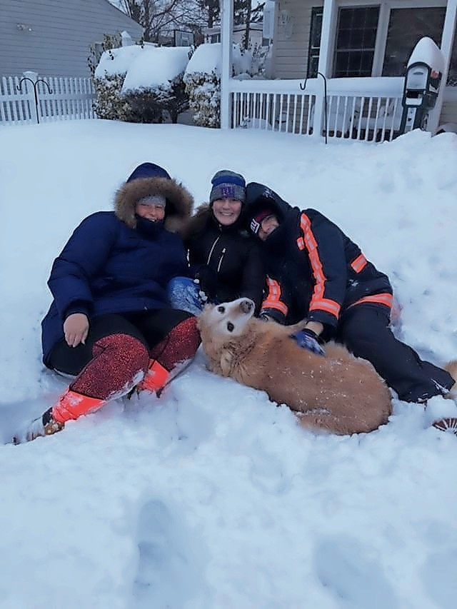 Samantha Cohen, left, Gabby Cohen and Max Cohen enjoyed playing in the snow with their golden retriever, Tasha, in Levittown.