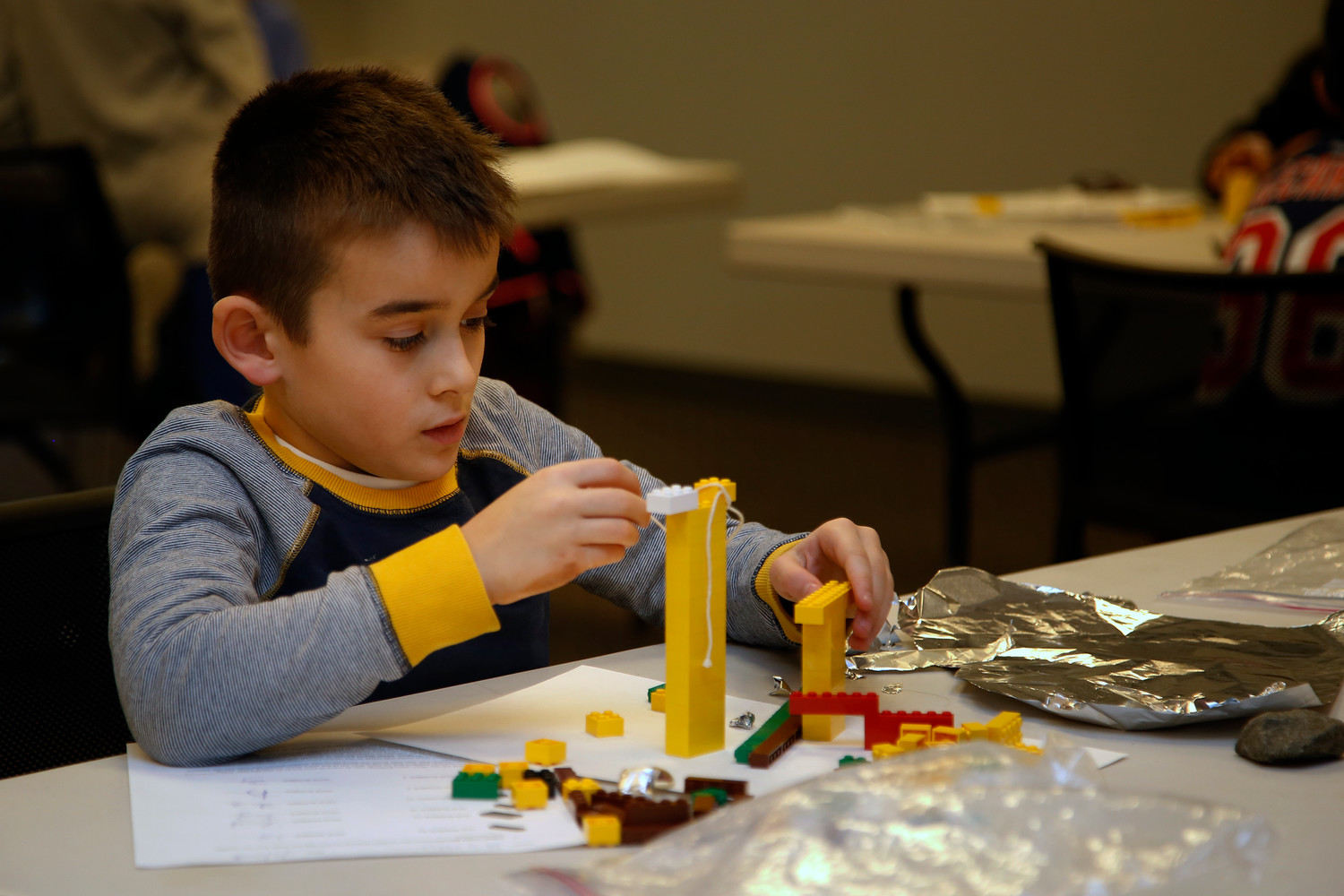 Ryan Lynch, 8, began his construction project with a pair of columns.