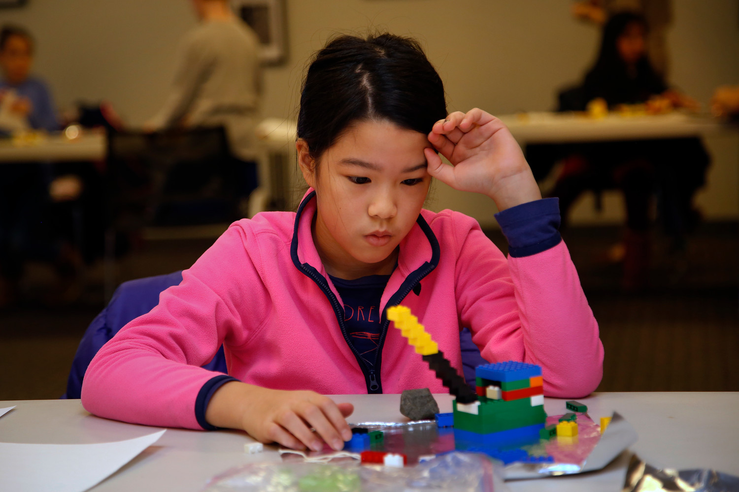 Tiffany Yam, 10, was deep in thought as she contemplated the next step of her Lego project. Yam was the first-place winner in the Block Kids competition at the Merrick Library on Jan. 7, and will move on to the regional competition.