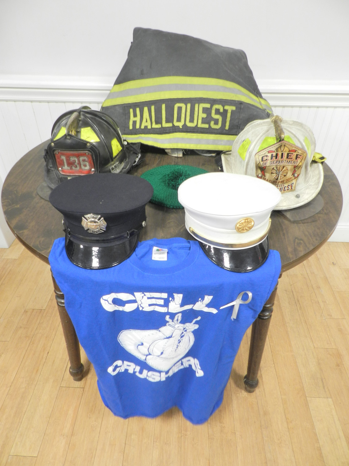 Hallquest's personal effects, including his firefighter's jacket, helmets and caps, were on display at the Sea Cliff firehouse after his wake.