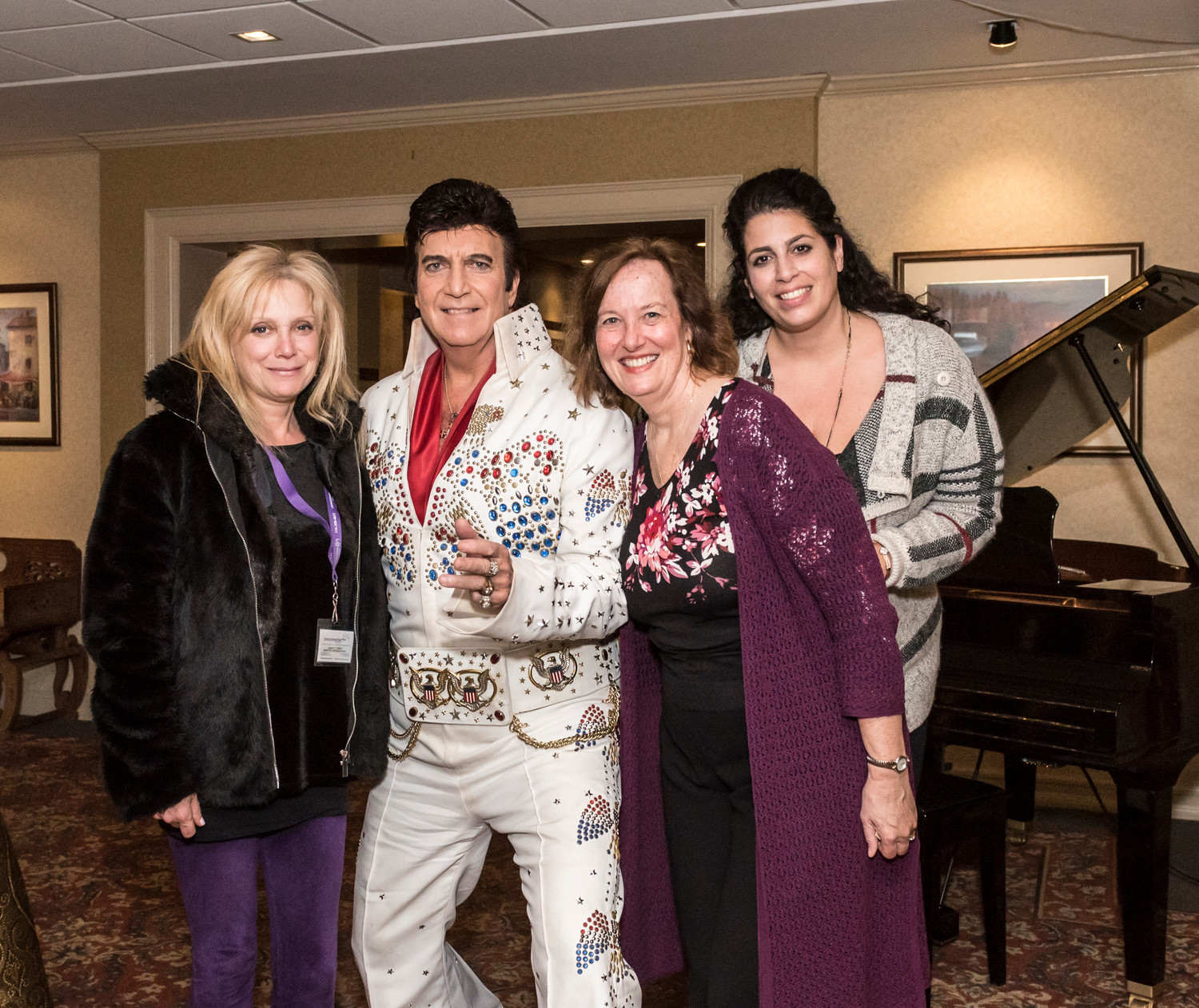 Elvis impersonator Don Anthony gave a signature King of rock 'n' roll stance with devoted fans Bonnie Rosen, left, Gail Kump and Stella Shank.
