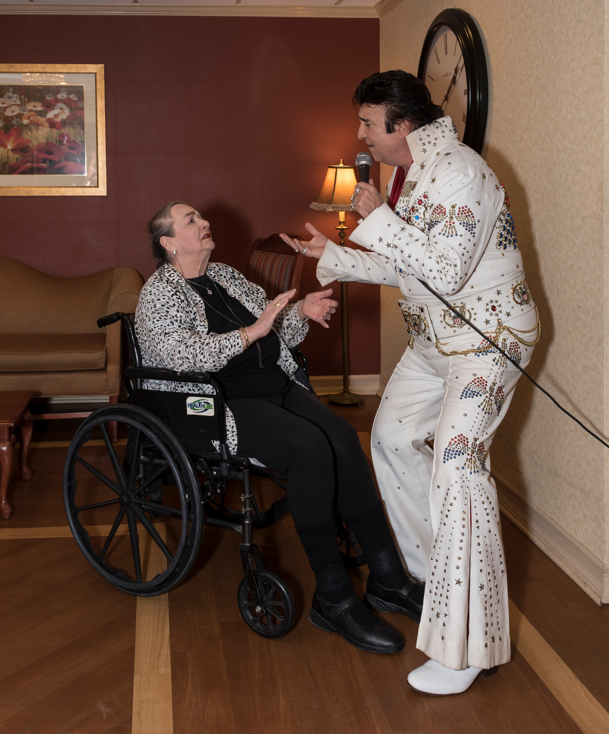 Elvis serenades Paula Nass at his 83rd birthday celebration at the Regency.